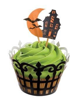 Great look for mini cupcakes.  Carrot cake with green cream cheese icing, sprinkles and a haunted house topper.