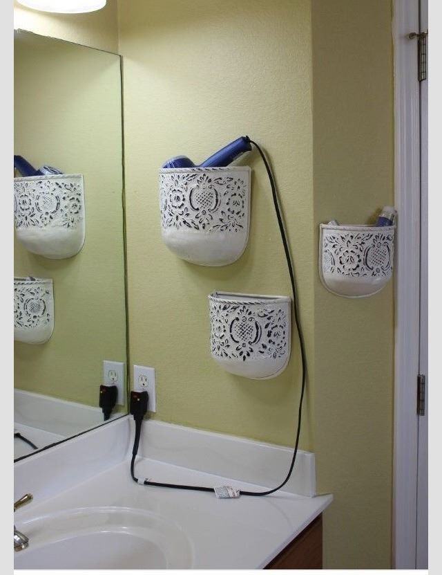 Tidy up your bathroom by re-purposing wall flower pots to store your beauty products!