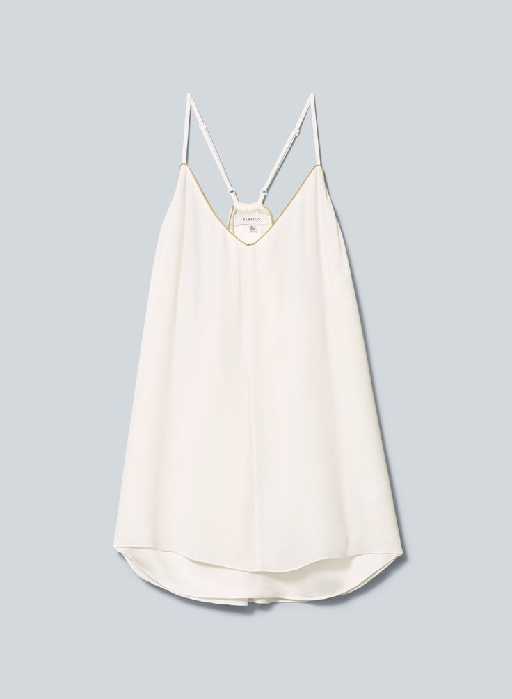 Elegant and simple white top. Would look super cute with jeans and sandals for summer!