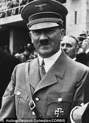 The German Chancellor Adolf Hitler (c) watches the 1936 Olympic Games in Berlin with the Italian Crown Prince