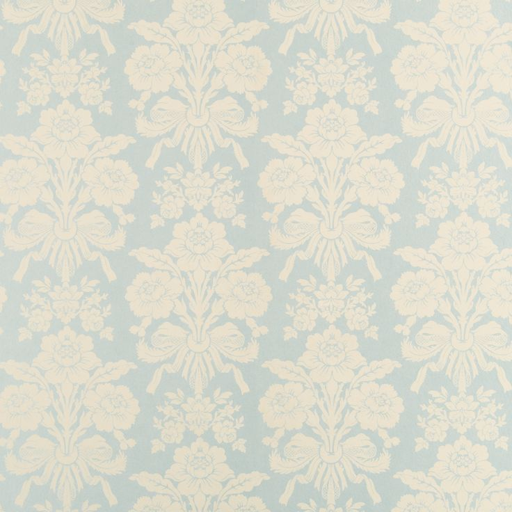 Wallpaper in the living room above the cream breadboard. By Laura Ashley
