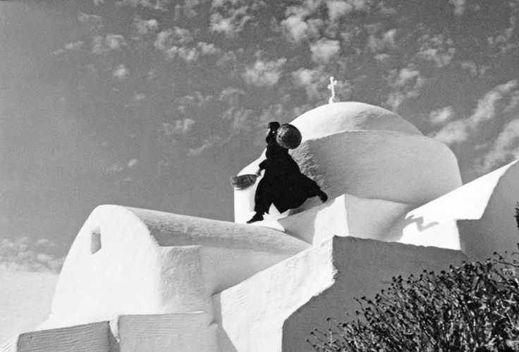 """Flying"" on the roof of the Antonios Abbey!  [Antonios Abbey, Kephalos, Paros island, 1970c.  Photo by Zacharias Stellas Benaki Museum Photographic Archives]"