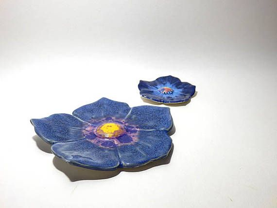 A Set of blue Ceramic flower sculpture, ring dish, Home Decor, Ceramics and Pottery, Wedding gift, birthday gift, Made from UK A beautiful set of bright blue ceramic flower dish sculpture are handmade by me, made from earthenware clay and glaze then fired twice in electric ceramic kiln. This set of delightful flower dishes is a perfect gift for mum, friend or yourself. Approximate Measures Large: Diameter--> 12.50cm Small: Diameter--> 7.00cm Price is for the set. Thanks for visiting...