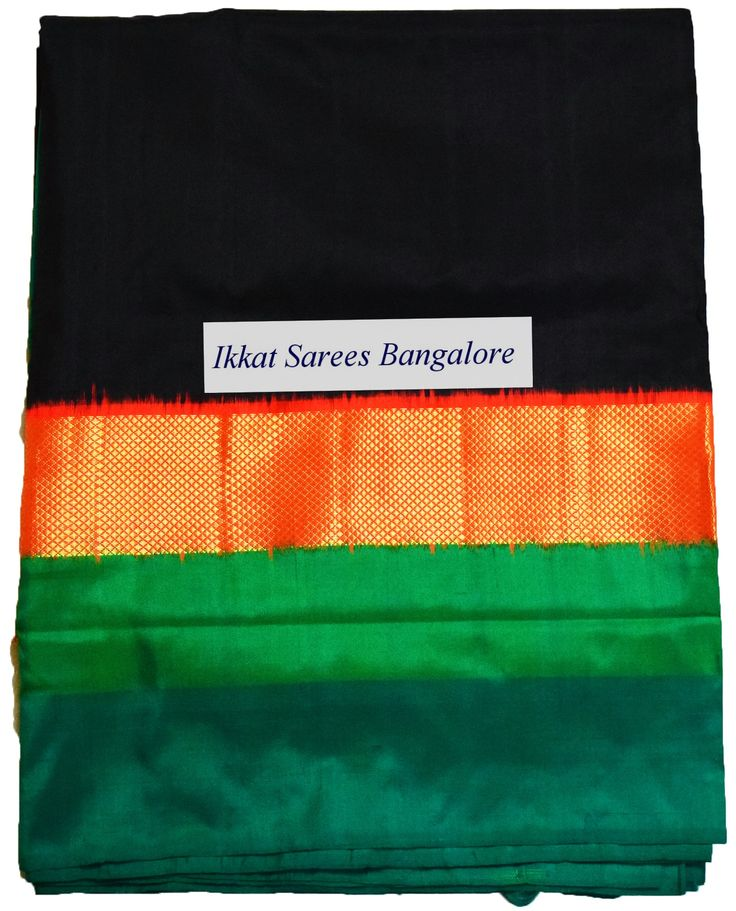 Gorgeous handwoven Ikat silk saree in black with striking dobby weave zari border and rich contrast patola pallu & blouse in green. Code: ISB5286 www.facebook.com/ikkatsareesbangalore Contact +918792177606