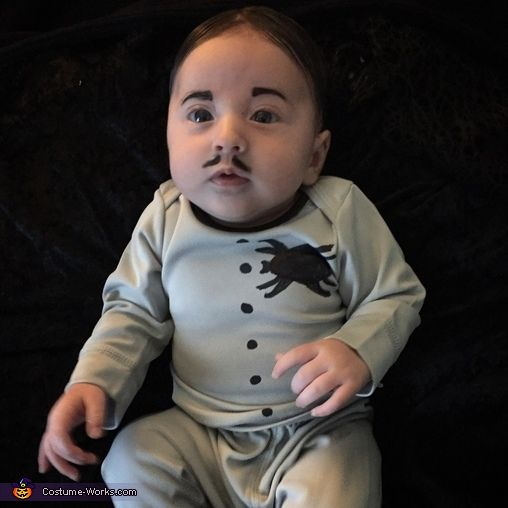 Brooke: My 2 month old daughter as Pubert Addams as part of a group Addams Family costume. She looks so much like the real deal! I bought a gray PJ set...