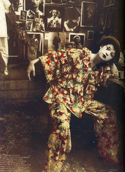 1960's British fashion designers Foale & Tuffin. This clown inspired garment consists of wide legged trousers and a matching frilly jacket with wide bell sleeves. The fabric is fun and colourful. I also like how the picture has been styled and the model is wearing clown styled makeup.