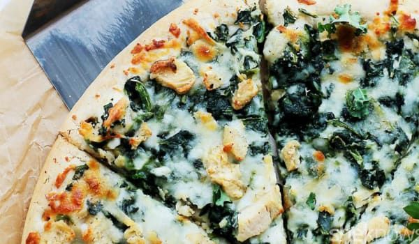 Can't get your family on board with the kale trend? This garlicky chicken and kale pizza will change their mind.