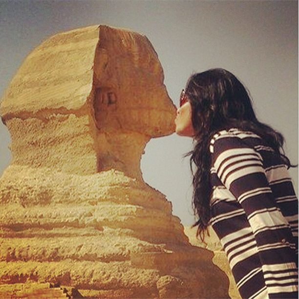 """Divya had to take some much needed """"crazy pictures', so she decided to kiss the Great Sphinx! The #GreatSphinx of #Giza, is a limestone statue of a reclining or couchant sphinx that stands on the Giza Plateau on the west bank of the #Nile in #Giza, #Egypt."""