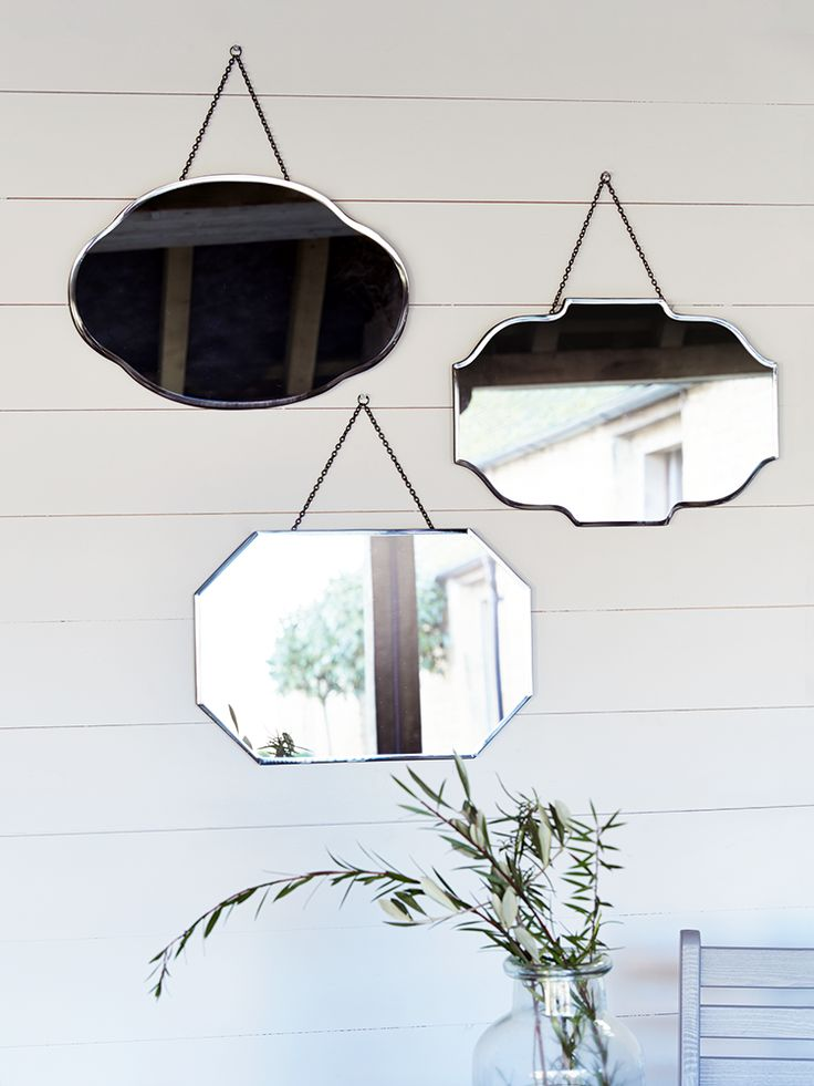 Each of our set of three small mirrors are finished in different striking vintage shapes, with a soft bevelled edge and hung on a simple metal chain. A brilliant alternative to your dressing table mirror, we recommend hanging all three at different heights or horizontally in a line. Why not display instead of wall art along the hallway or in your dining space?