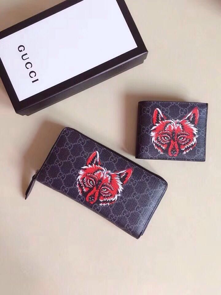d67cc026f448 Wolf head print GG Supreme wallet. Find this Pin and more on Gucci bag ...