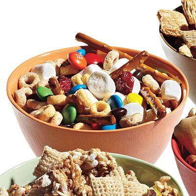Sweet- Tooth Mix: 2 cups pretzel sticks, 2 cups Multigrain Cheerios, 1 cup mini marshmallows, 1/2 cup M's, 1/2 cup raisins. (1/2 cup= 106 calories)
