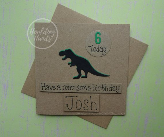 Unique handmade dinosaur birthday card. This T-Rex card for children or adults with added name and age would make the perfect card for a son or daughter. This personalised birthday card with age and name has a silhouette of a Tyrannosaurus Rex with an added disc with the age added. The colour of the shadow of the T-Rex can be selected from the drop-down menu on this handmade dinosaur card. The sentiment on this Happy Birthday card is added with 3D foam and reads: Have a roar-some birthday…