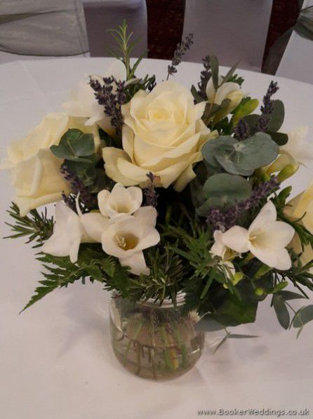 White Wedding flowers - Lavender and Cream Jars of Flowers for Reception Table Arrangements with Roses, Freesias and Lavender at Sefton Park Hotel | Wedding Flowers Liverpool, Merseyside, Bridal Florist, Booker Flowers and Gifts, Booker Weddings| Specialist Wedding Flowers