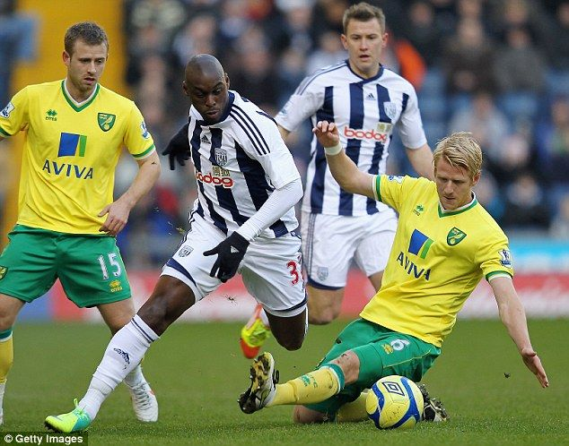 Zak Whitbread (right) was an ever-present for Norwich in one of their best top flight seasons