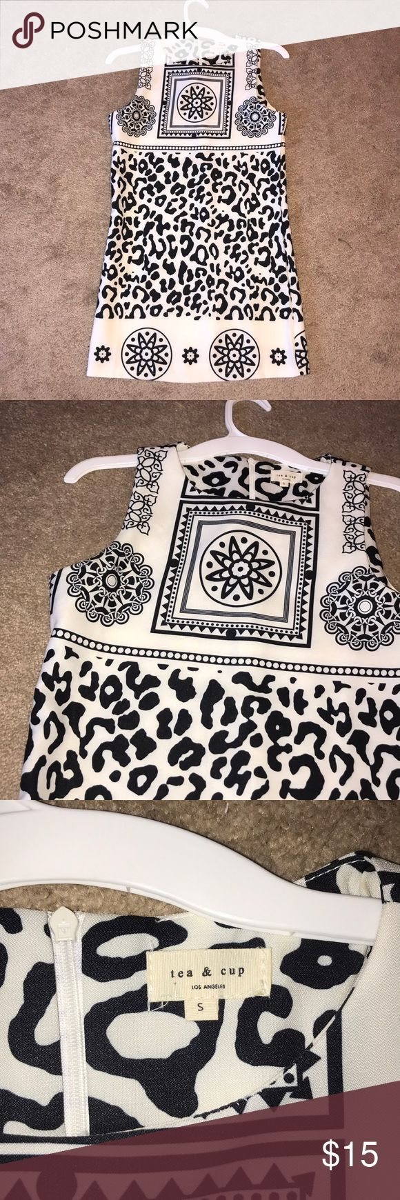 Tea and Cup Printed Dress CUTEST black and white shift dress!! Perfect for events YEAR ROUND. Love the cheetah print across the middle.   Size S and fits like so. Hits about mid-thigh. Zips up the back. This dress is NWOT! Tea n Cup Dresses Mini