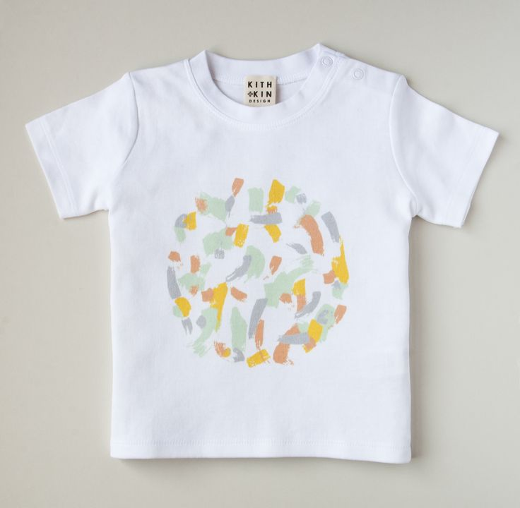 Gender neutral t shirt for babies. Made in a soft and stretchy cotton with 2 poppers at the side neck for greater ease when dressing. Printed in the UK. Ethically made.