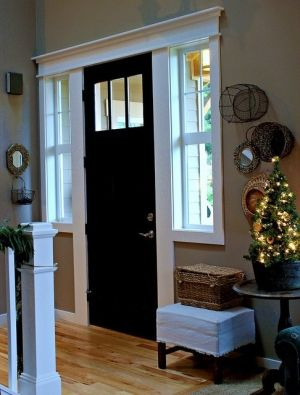 love the black door and storage ideas for small space front entry