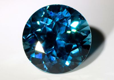 Blue Zircon.  Heating zircons in an oxygen-free atmosphere produces the blue coloring, which can then be heated in air to give a golden color.