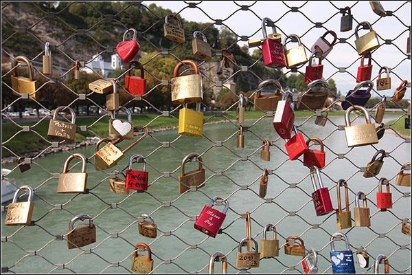 Salzburg at river Salzach - view from Makartsteg bridge with locks – Salzburg, Austria/Österreich