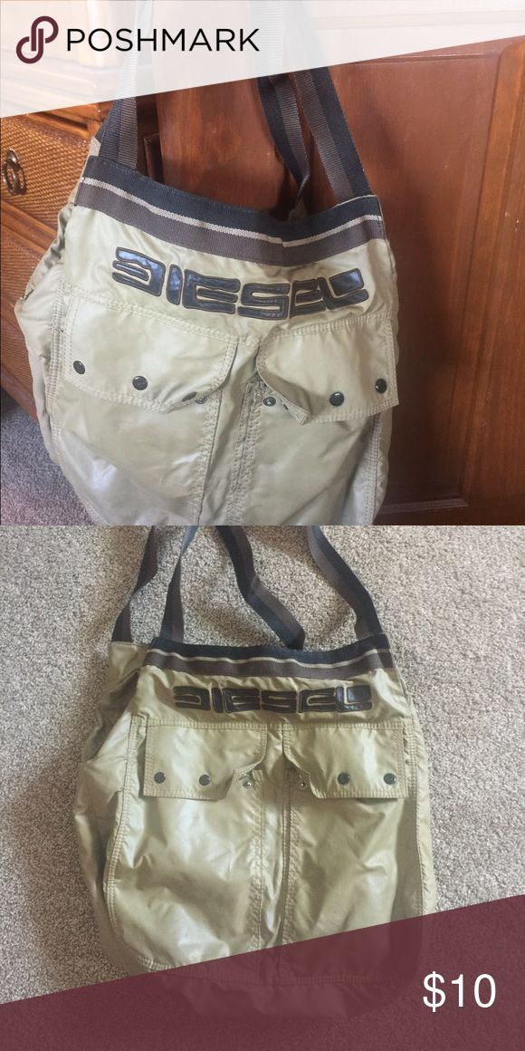 Diesel handbag, gym bag, shoulder bag, Diesel handbag, gym bag, shoulder bag, there are several stains on the bottom and side because I used it as a school bag. But it has no rips or tears. Price reflects stains Diesel Bags Totes