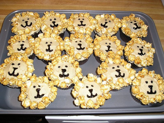 rawr! lion cupcakes! you can use chocolate chips as eyes, pretzels as whiskers, and cheerios as ears :D
