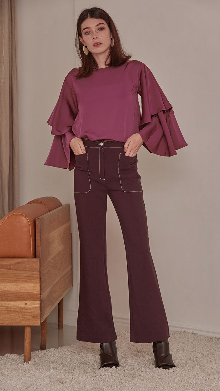 Rocha Pant in Wine. Two front pockets, zipper fly, tap closure. Styling in contrast white stitching. Straight cut, flare out hem. Cut for a slim fit. COMPOSITION AND CARE Dry Clean Only Updating Soon