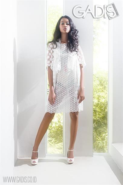 Sheer white dress with bikini underneath. Sexy!