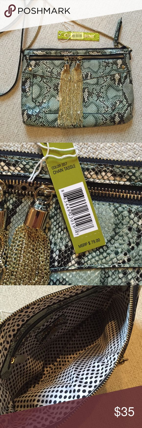 NWT Gianni Bini Crossbody purse NWT Super cute snakeskin print Gianni Bini Crossbody purse. Front zip pocket with gold tassels. This purse will add a pop to any outfit. Gianni Bini Bags Crossbody Bags