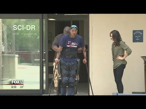 Suit allows paralyzed veteran to walk again - YouTube