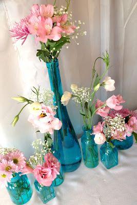 aqua vases/jars and pink flowers