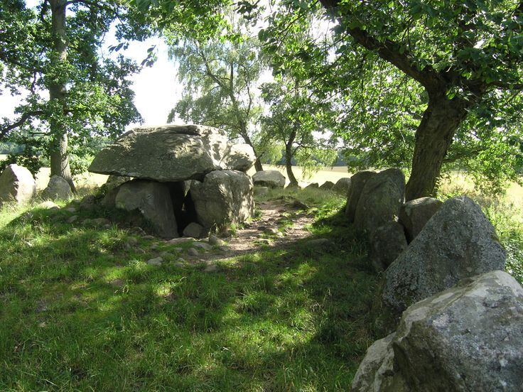 The Kings Dolmen (Kongedyssen) in Tokkekøb Hegn, Allerød municipality, Zealand in eastern Denmark. A dolmen, also known as a portal tomb, portal grave or quoit, is a type of single-chamber megalithic tomb, usually consisting of two or more upright stones supporting a large flat horizontal capstone (table), although there are also more complex variants. Most date from the early Neolithic period (4000 to 3000 BC).