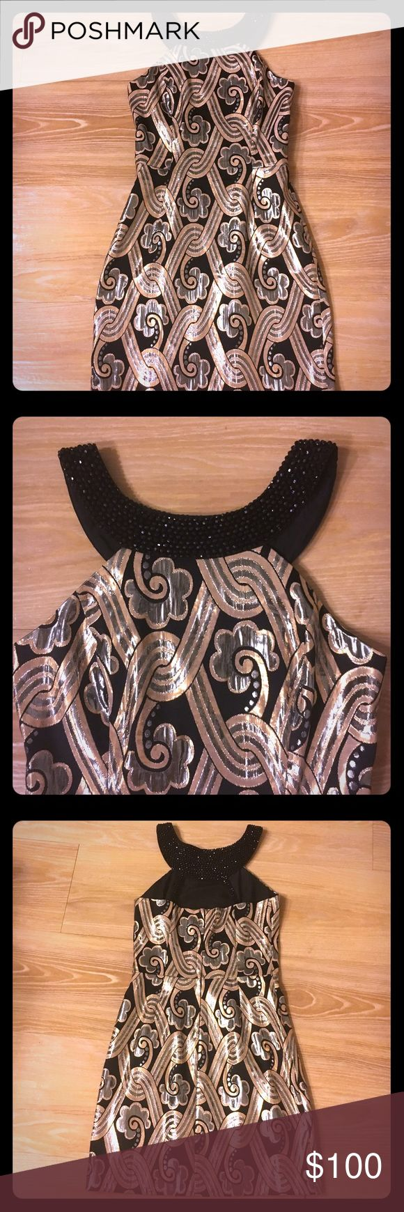 LILLY PULITZER 🌟 black and gold dress w/ beading GORGEOUS Lilly dress with some many details. Beautiful black beading through out the halter and back of the dress. All of the beading is still intact and very durable. Beautiful metallic gold details on the print of the dress. Perfect for New Years Eve or holiday parties! Lilly Pulitzer Dresses Mini
