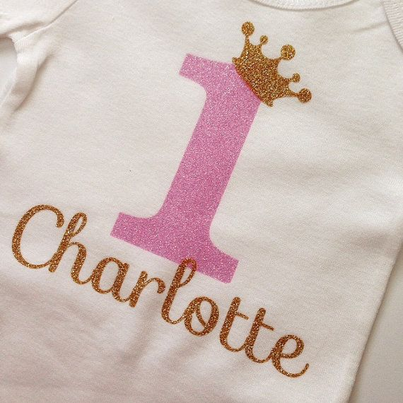 ♥ 1st Birthday Shirt ♥ This listing is for 1 birthday shirt with a beautiful vinyl light pink (raspberry color) glitter 1, gold crown and name