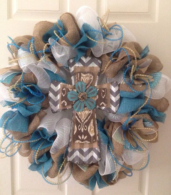 Absolutely stunning white deco mesh and natural burlap wreath with a gorgeous metal gray and white chevron cross with turquoise flower in the