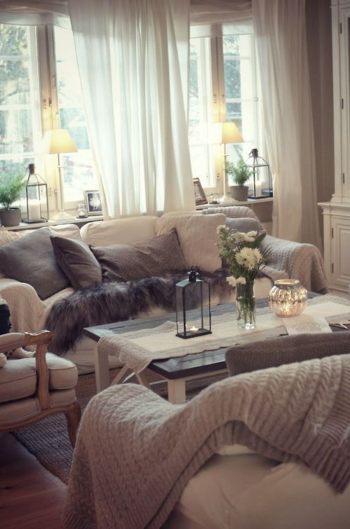 Calm, cozy, and inviting sheers for living room windows, all the way tongue floor! Love the feel in this room