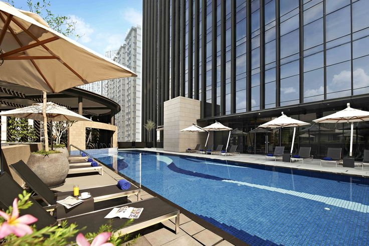 Taking a dip in the pool now! In the Carlton City Hotel Singapore