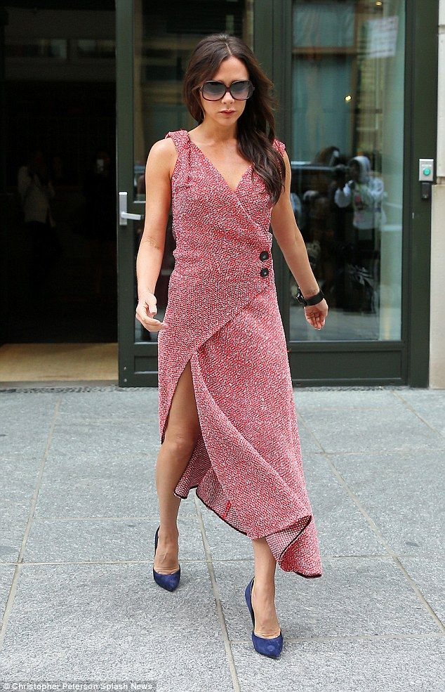 Switching it up: Victoria Beckham decided not to wear black for once and added indigo shoes to the...