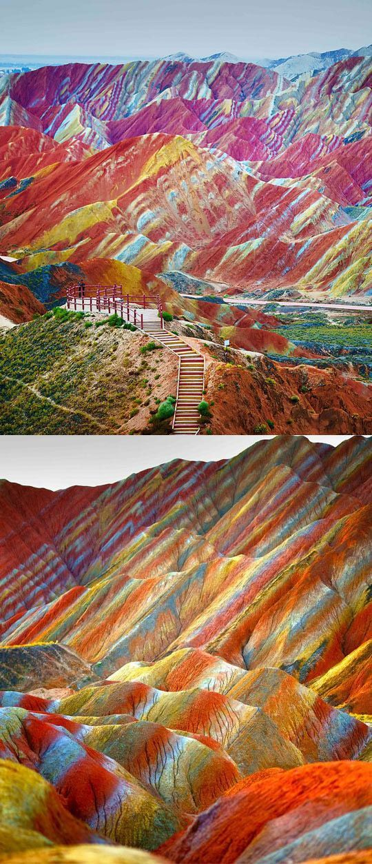 Danxia Landform Geological Park in Gansu, China. The rainbow mountains became a UNESCO World Heritage Site in 2010.  The colors are the result of mineral deposits and red sandstone.