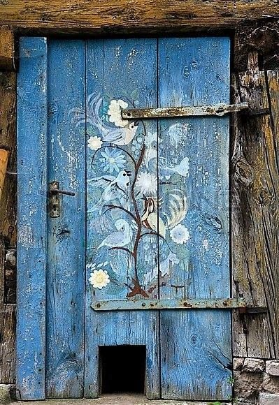 Would love the back garden gate to look like this. Such a beautiful door, but note the cat hole ....