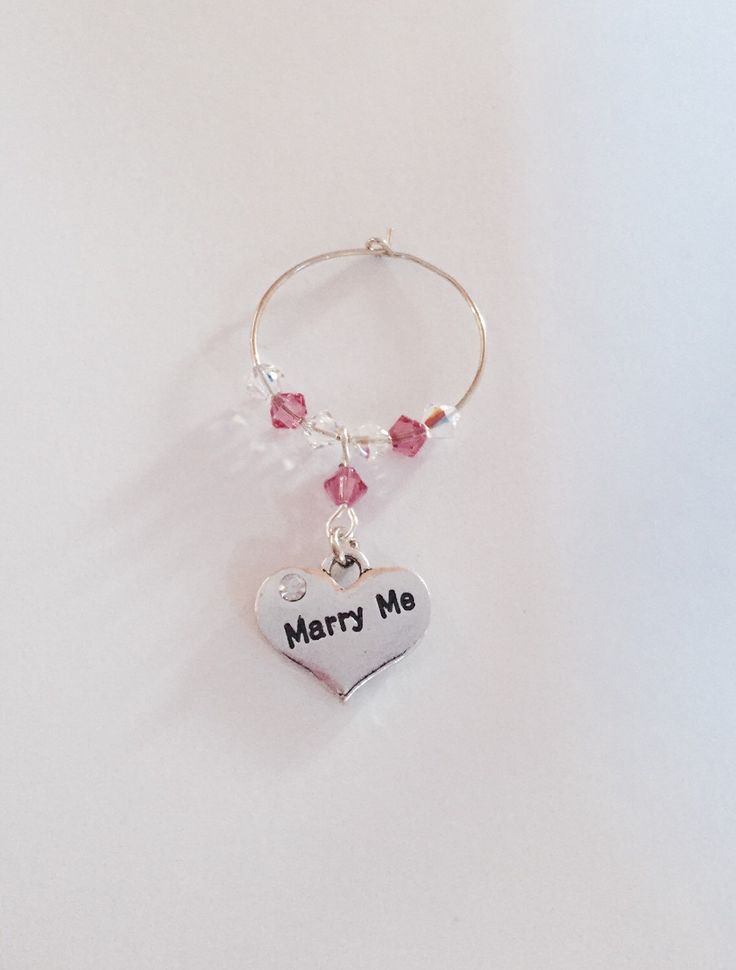 A personal favourite from my Etsy shop https://www.etsy.com/uk/listing/267485317/marry-me-wine-glass-charm-wedding