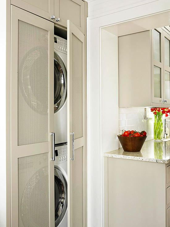 Small-Space Laundry Closet A full-size laundry room might not be an option for some condos, apartments, and small homes. This stacked washer and dryer tucks away in a slim closet off of the kitchen and uses nearby cabinets for storage. Perforated door panels add visual interest and ventilate the laundry area while keeping the appliances out of sight.