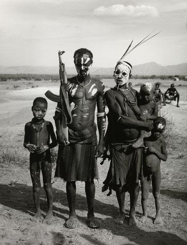 Tribal family with AK 47 Rifle, Omo Valley, Ethiopia, 2002 - Don McCullin