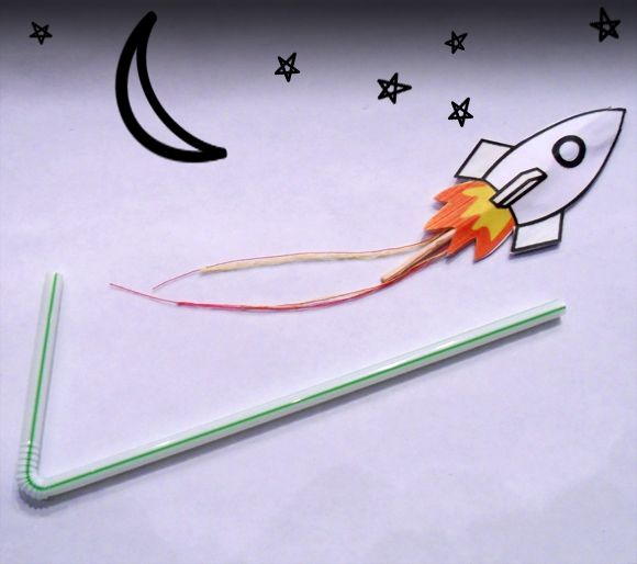 DIY flying rocket, made with a bendy straw, paper rocket ship and toothpick