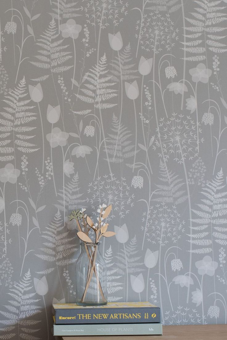 Charlotte's Garden in 'mist', a soft grey, by Hannah Nunn - a wallpaper inspired by the flowers in bloom in the Brontë Parsonage garden around the time of Charlotte Brontë's birthday. It features ferns, alliums, forget-me-nots, hellebores, fritillaries and tulips. A beautiful surface pattern design of spring flowers.