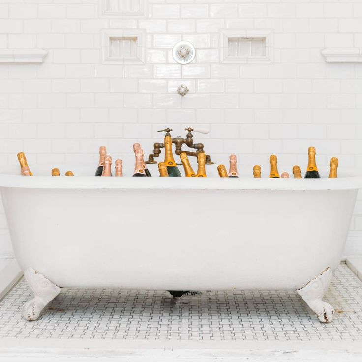 my kind of party! | champagne | claw foot tub