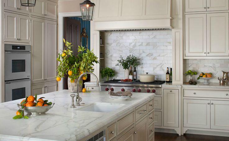 calcutta gold subway tiles backsplash sink in kitchen island