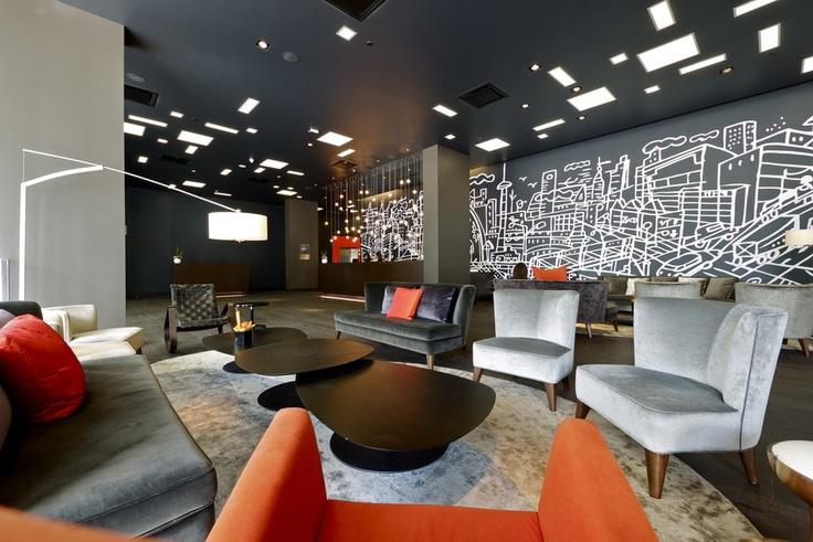 Gray and orange accent the lobby of the Thompson Hotel, Toronto, designed by Studio Gaia. Photo: Courtesy of Studio Gaia