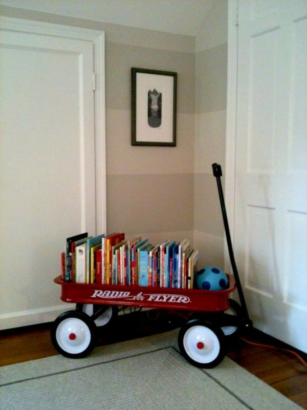 Here is an example of red wagon book storage in a kid's room.
