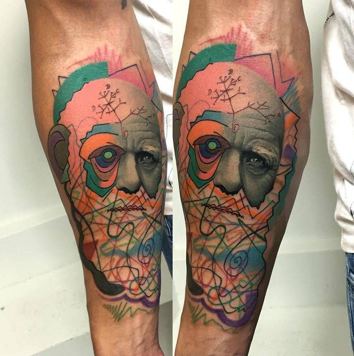 Darwin's mashup portrait tattoo on the inner forearm.