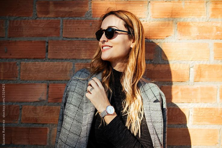Portrait of stylish woman with coat by Susana Ramírez for Stocksy United